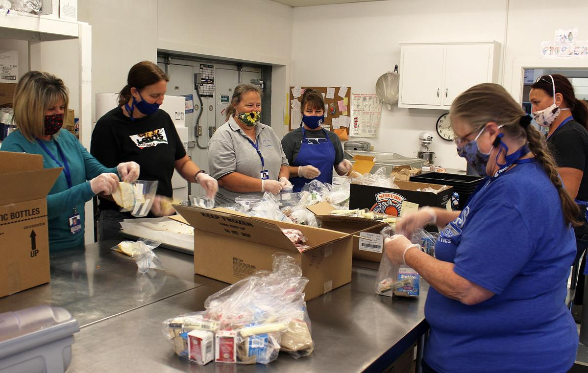 CSD Food Service workers packing meals