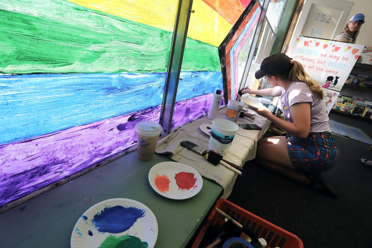 Chapter One Bookstore's windows fill with rainbows in support of high school students