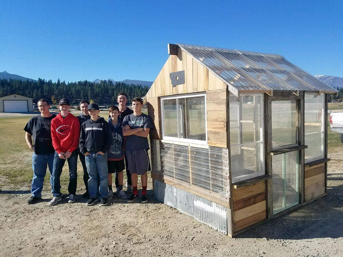 DHS student by H4H greenhouse