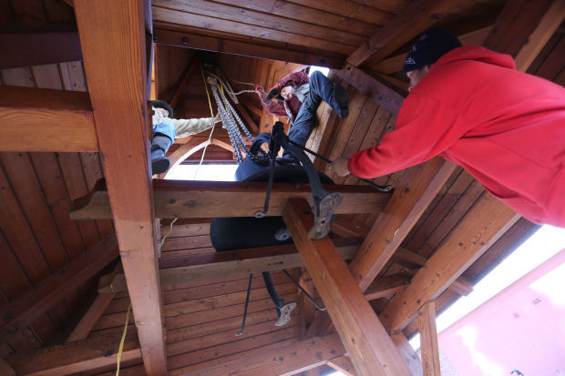 Moving to the museum: Volunteers remove historic bell from Grantsdale School campus