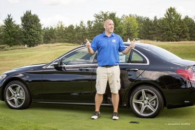Against all odds: Traverse City golfer wins new car with hole in one
