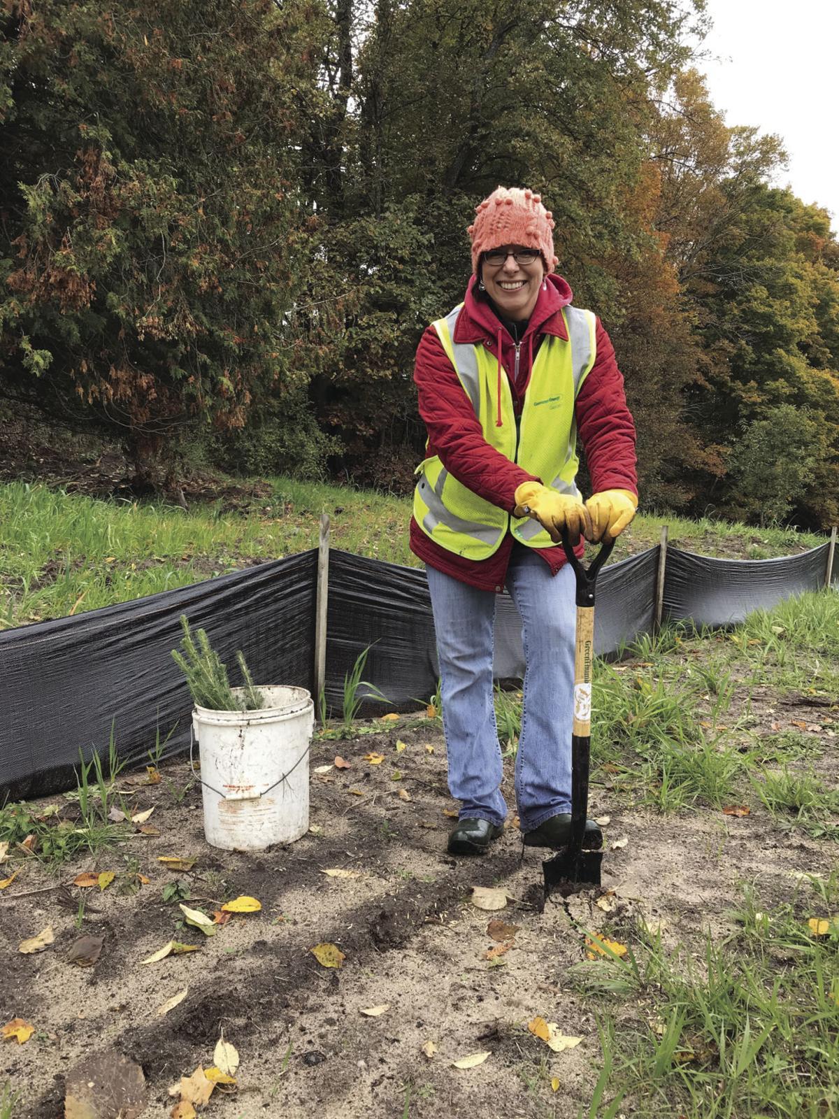 Volunteer team leader plants trees