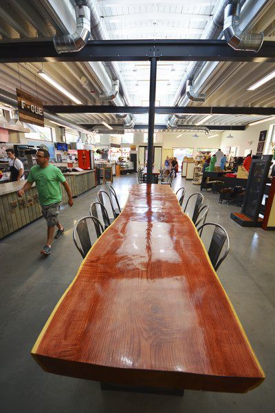 Record Eagle/Dan NielsenThe Bar And Tables In State Street Market Were Made  By Mark Waldrup Of Edge Modern Furniture Design In Traverse City.