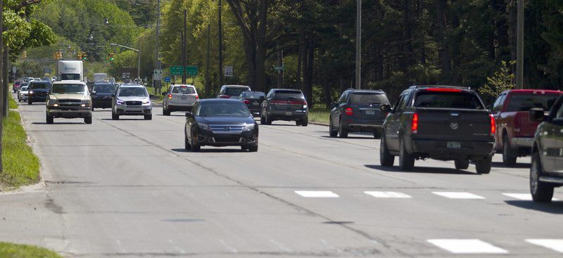 Grassy median, turn lanes coming to Division St.