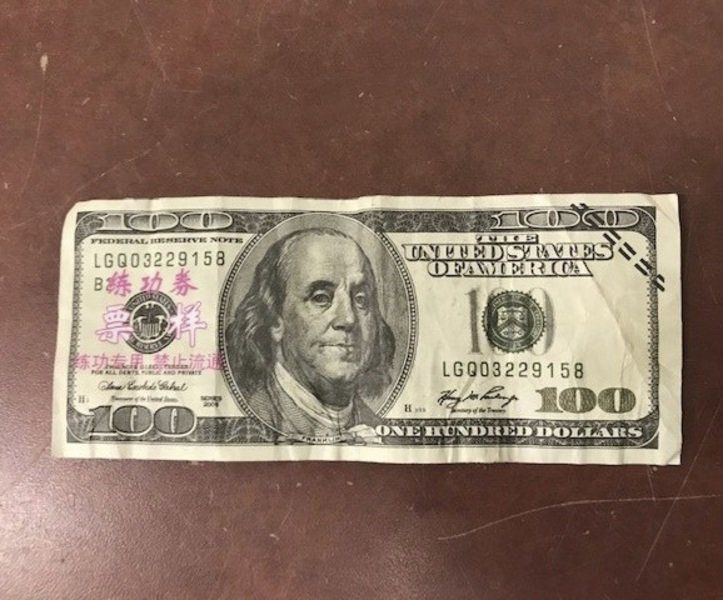 Phony as a two dollar bill meaning