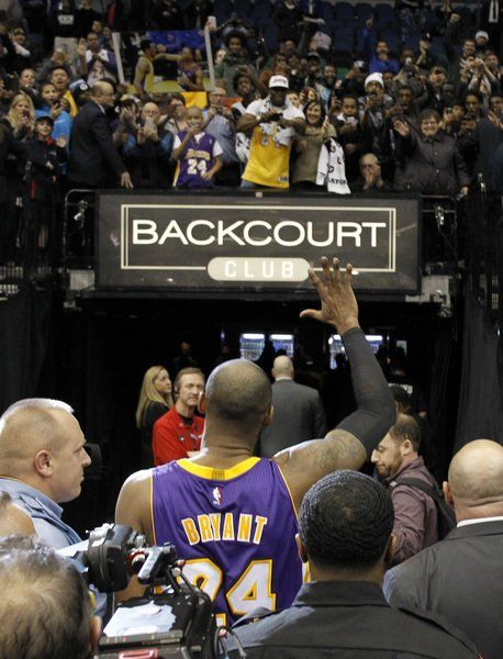 78e8f35ab17 Kobe talks about the fire needed to catch Jordan. Los Angeles Lakers guard  Kobe Bryant waves to fans ...