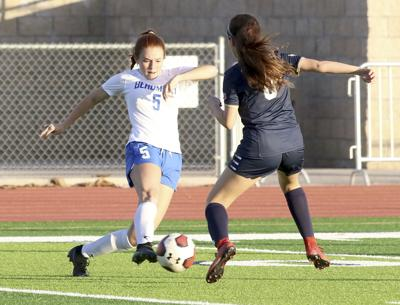 Cougar Jones avoids Yucaipa's Avalos to pass to her teammates on Sunday.