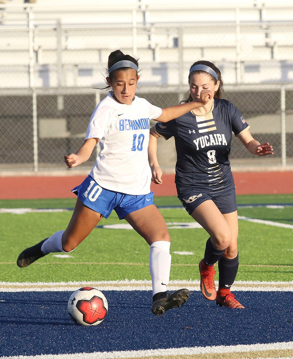 Cougar Melainie Murillo kicks the ball away from T bird Thalia Avalos