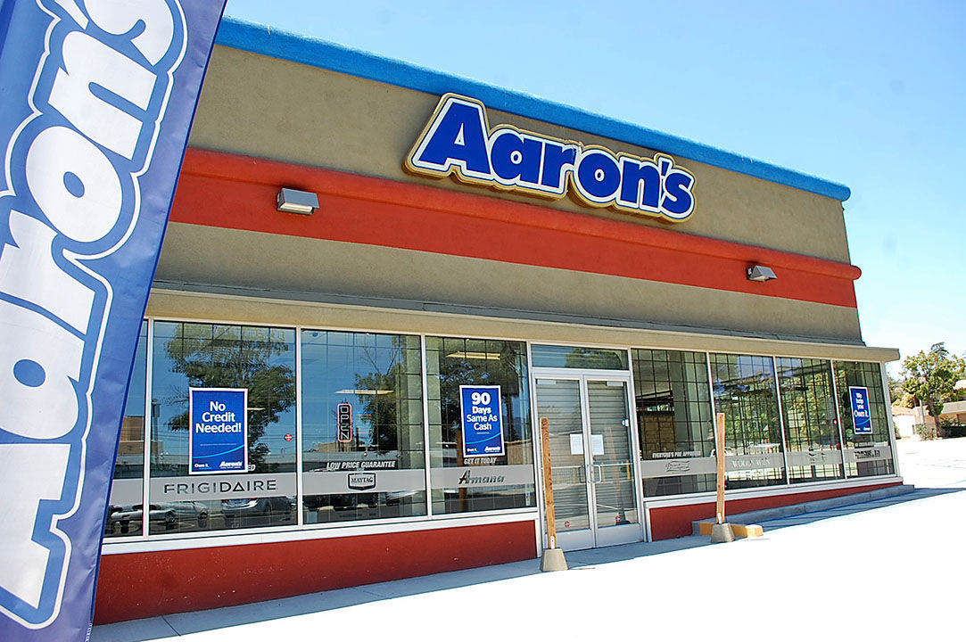 Gone Bust: The Former Aaronu0027s Furniture Store In Banning, With Its Roll Up  Security Door In Place.