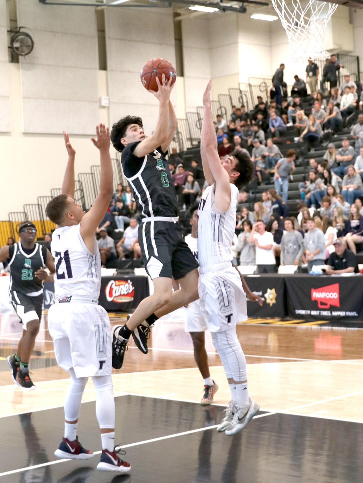 Bronco Richard Espinoza delivers two of his eight points as Banning wins CIF title.