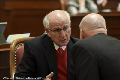 Image of striking teachers holding signs on a sidewalk