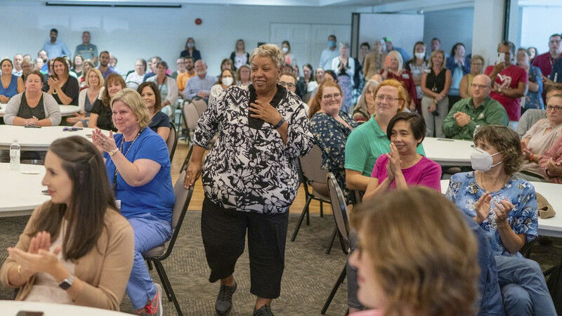Former healthcare worker surprised with $1M check through vaccination lottery
