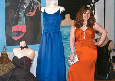 cb51253e914 Meri Zirckel models a prom gown alongside a display at Trio Consignments in  Beckley. Many designer-named gowns find their way into consignment shops  and ...