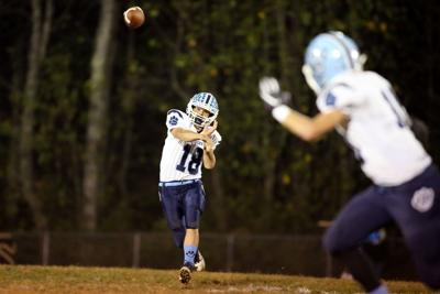 Adkins leads Wildcats to first win