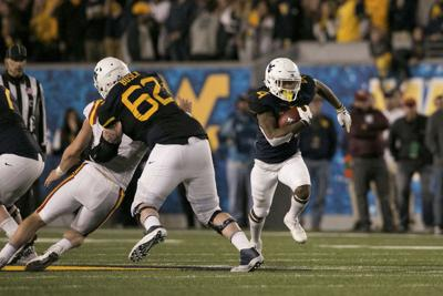 Luck of the draw: WVU downs No. 14 Iowa State | College ...