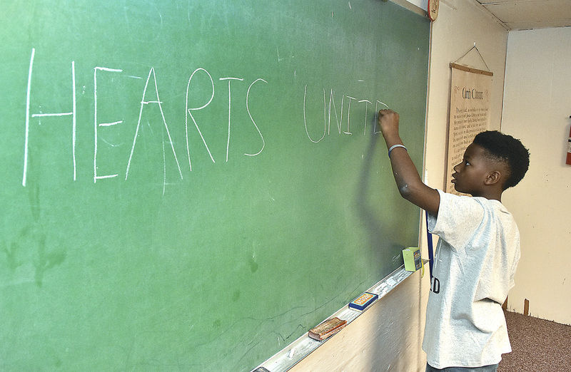 Nine-year-old honors father's legacy through heart education
