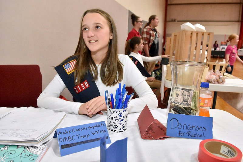 Local girls troop raises money to help mentor with cancer treatment