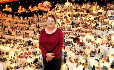 mary roose of danese stands with her display of more than 400 christmas village houses inside her home roose has been displaying christmas villages for