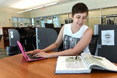 Nikki Ellis Looks Over Her School Work At The Erma Byrd Higher Education Center In Beaver The 29 Year Old Wyoming County Resident Is Taking Online Classes