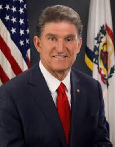 Manchin says he's staying put; talks guns, immigration and climate