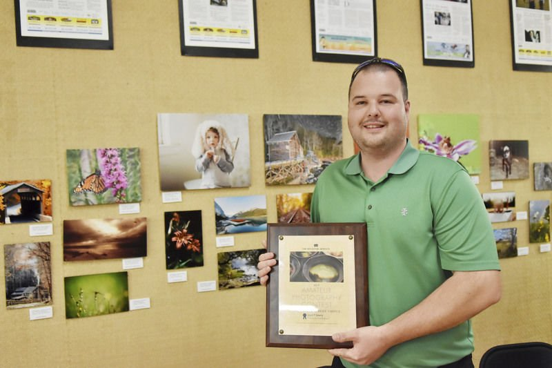 Photographers honored by The Register-Herald