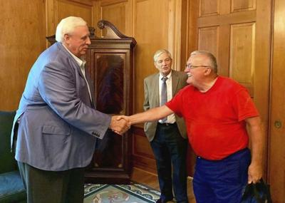 Stover completes walk, meets with Gov. Justice