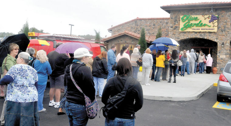 before the doors open to olive garden people stand in line from the front door to the parking lot to be the first ones to eat at the newly opened restaurant - Olive Garden Morgantown Wv