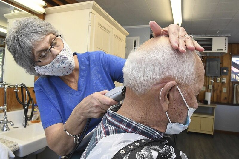 Beckley barber shop reopens after flood damage