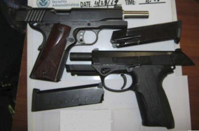 Man stopped at airport with 2 guns, ammo