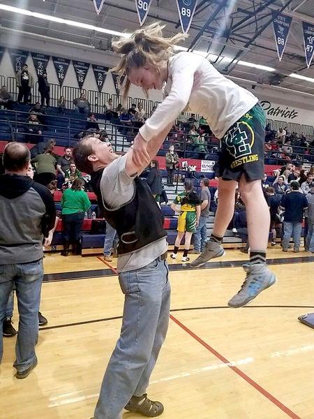 Fisher, Taylor win girls wrestling titles