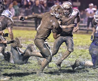 Wildcats conquer 'Hounds in the mud