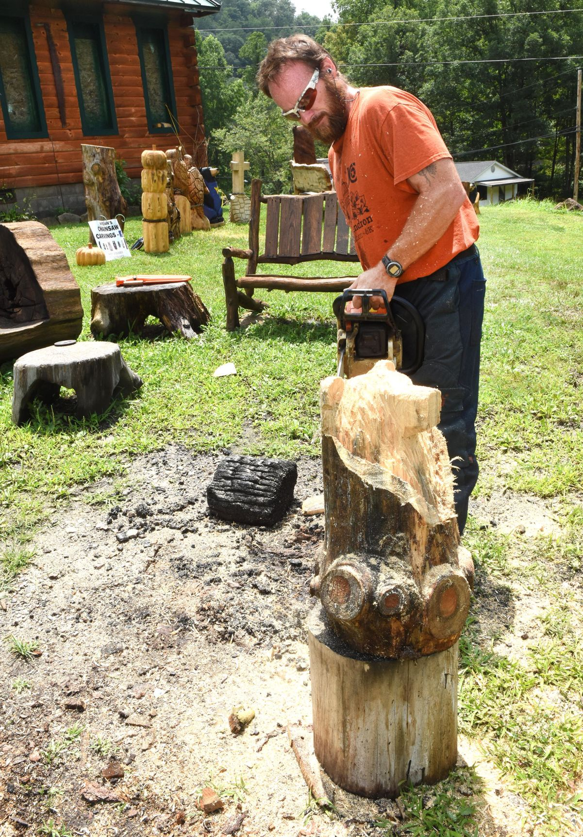 Chainsaw carved bear holding a carved welcome sign etsy