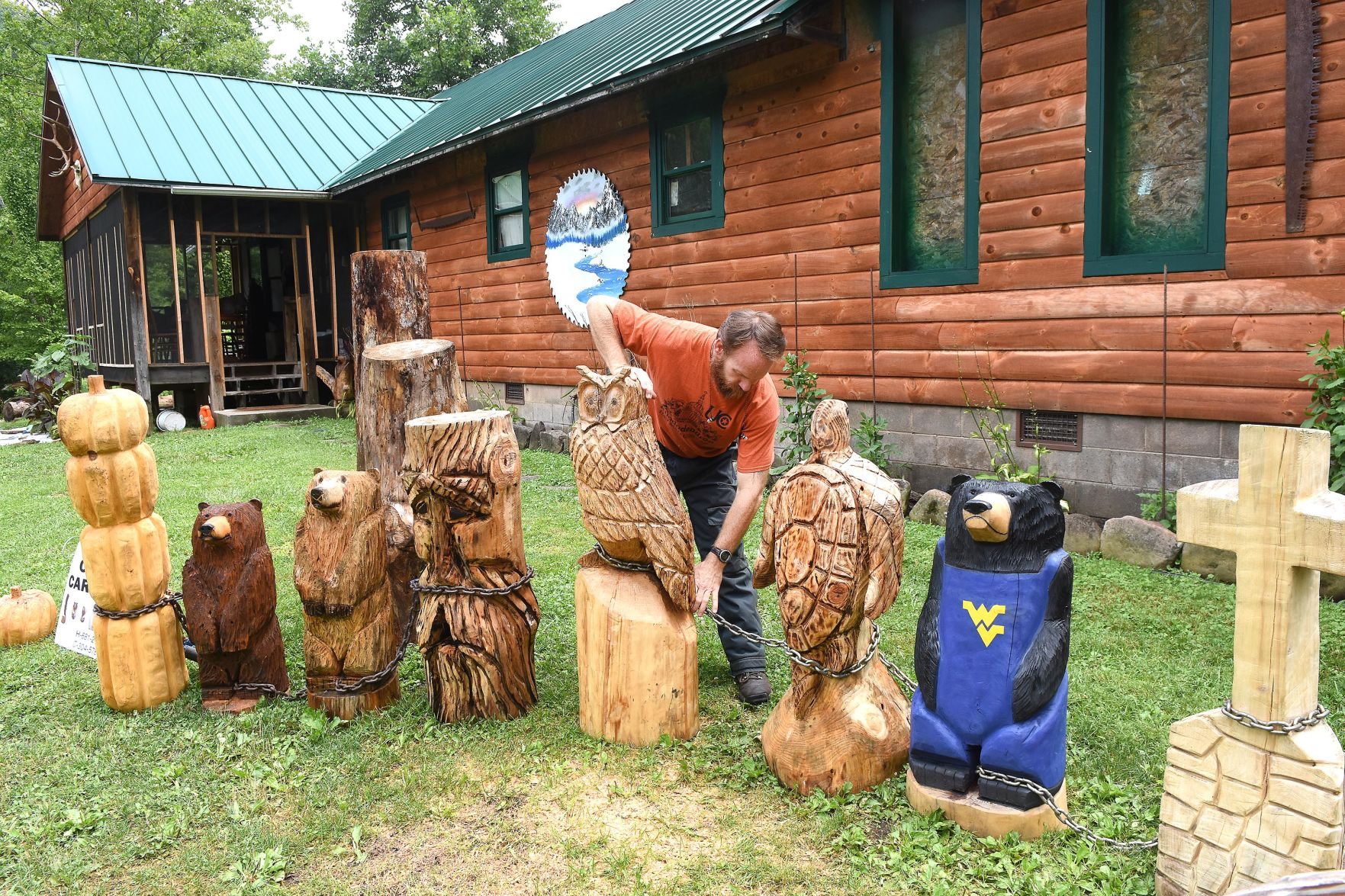Chainsaw carved bear with a heart u make it magic