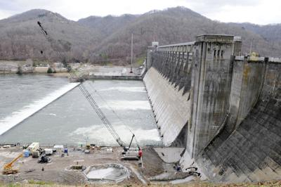 Officials celebrate the end of phase four construction at Bluestone Dam