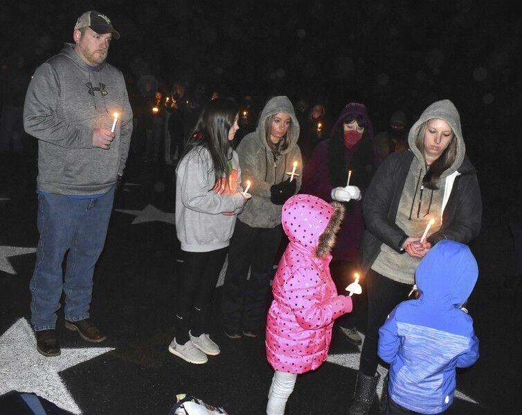Vigil honors two victims of Friday crash