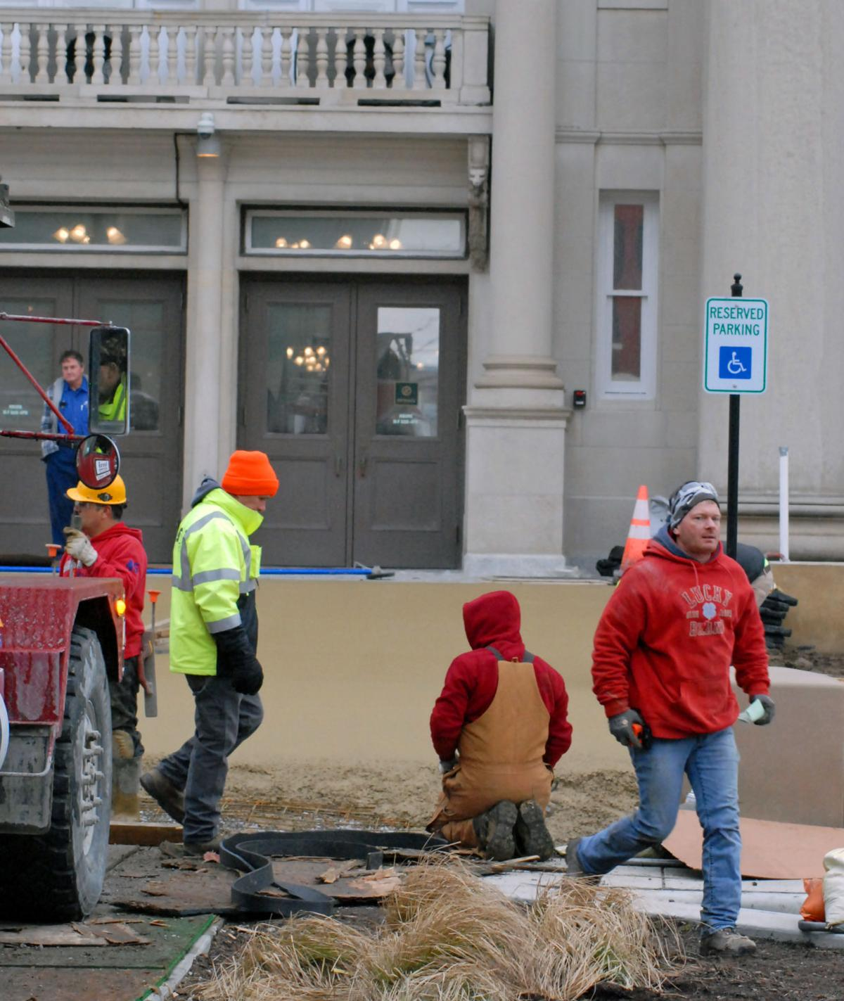 Crews pour ramp to courthouse