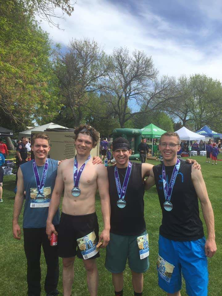 Withers gathers with some friends after the Teton Dam Marathon. Left to right: Aaron Withers, Mike Lerohl, Spencer Zapata, Bryce LeBaron.