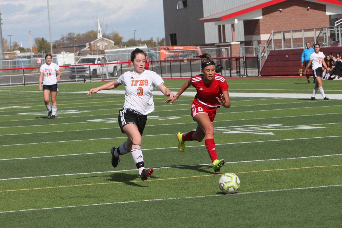 Madison's Savannah Summer races an Idaho Falls player for the ball.