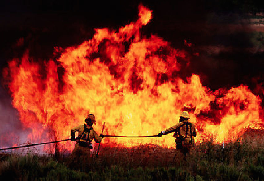 Firefighters battling wildfire that ignited along Highway 30
