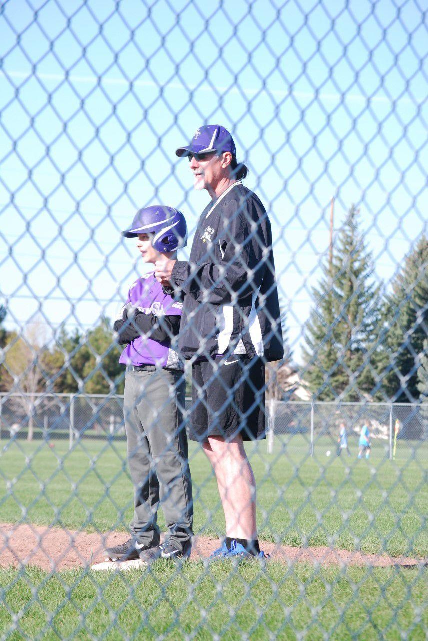 New North Fremont baseball coach Scott Marrett stands by a North Fremont baseball player as he stands on first base.
