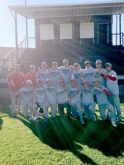 Madison Cats pose for a photo in Twin Falls after winning the Donnelly tournament.