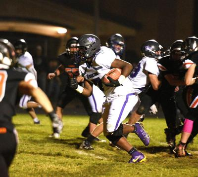 North Fremont running back Deshon Wheeler breaks through the scrum and heads downfield during the Huskies' 22-14 win over Aberdeen Friday.