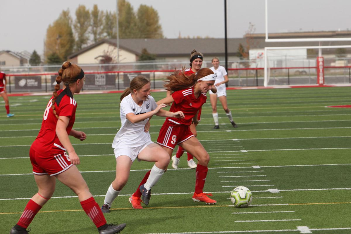 Madison's Anna Tonks breaks away from a Rigby defender.