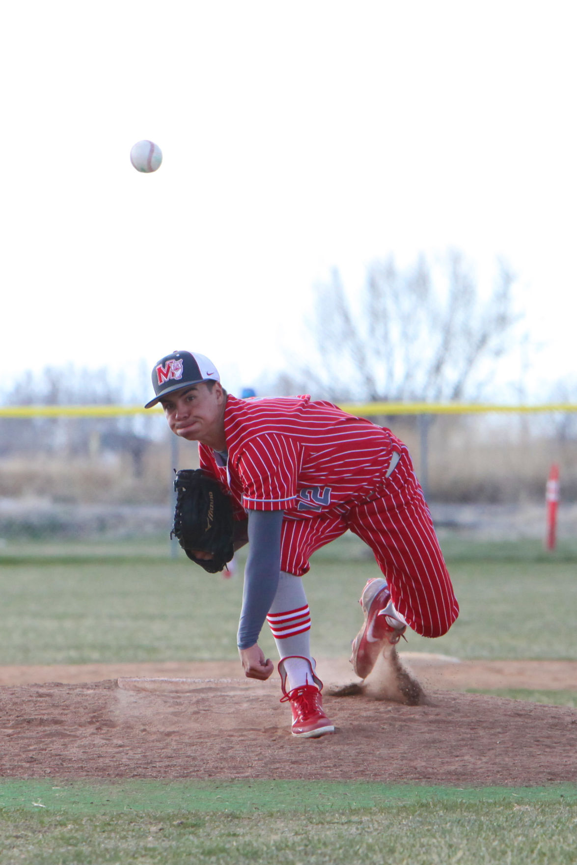 Madison's Tyler Pena unleashes a pitch against Rigby.