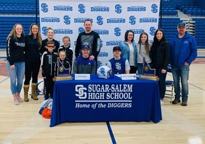 Riley Thurber and Keayen Nead sign their letters of intent