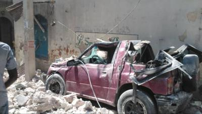 Image of vehicle hit by debris during August 14 earthquake in southern Haiti.