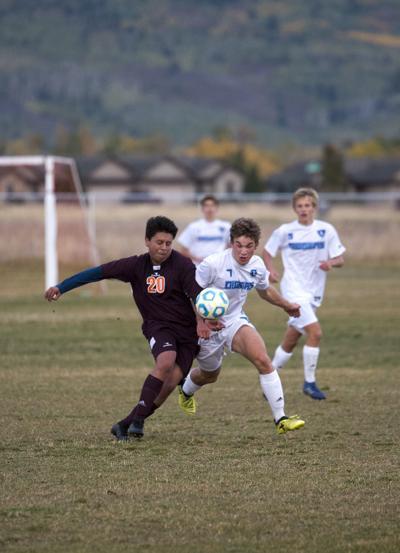 Sugar-Salem's Joshua Rhoton and Teton's Bryan Olvera fight for the ball