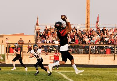 South Fremont's Easton Kerbs goes up to make a catch.