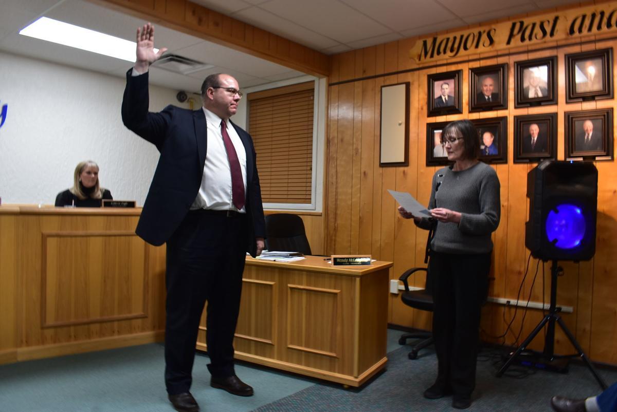 Sugar City Mayor Steve Adams is sworn into office on Thursday
