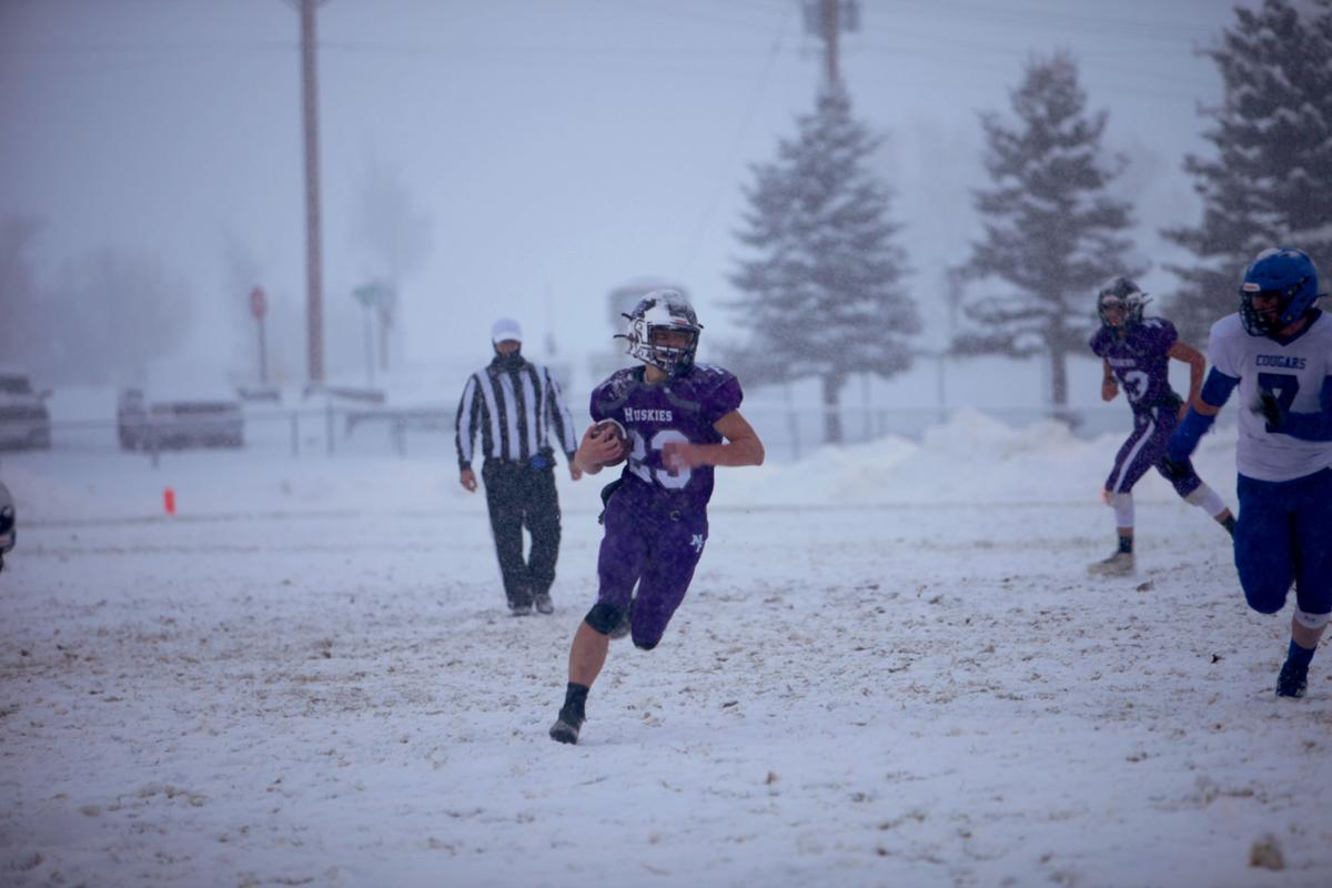 North Fremont's Jordan Lenz carries the ball down the field in their semifinal matchup with Firth.